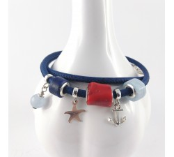 cure beads bracelet with red coral lapis lazuli aquamarine with sterling silver charms on navy cork