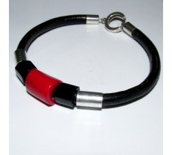bracelet on black leather strap with red coral cylinder and two black agate besides sterling silver