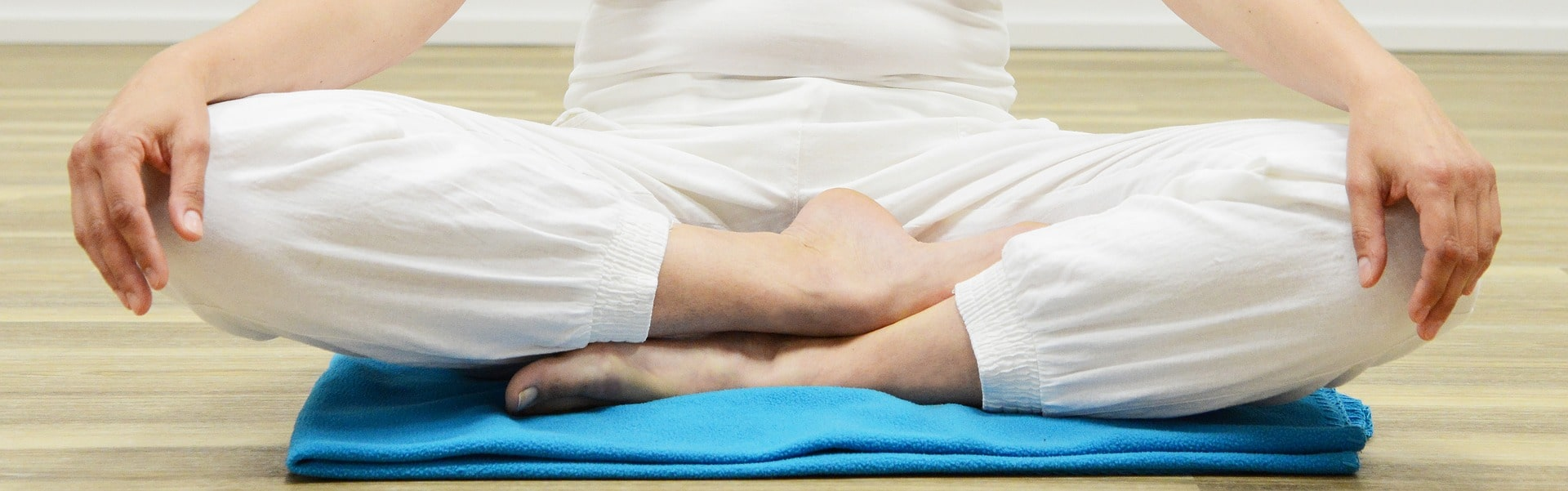 meditation-sit-on-blanket-white-pans-with-hands-on-knees.jpg